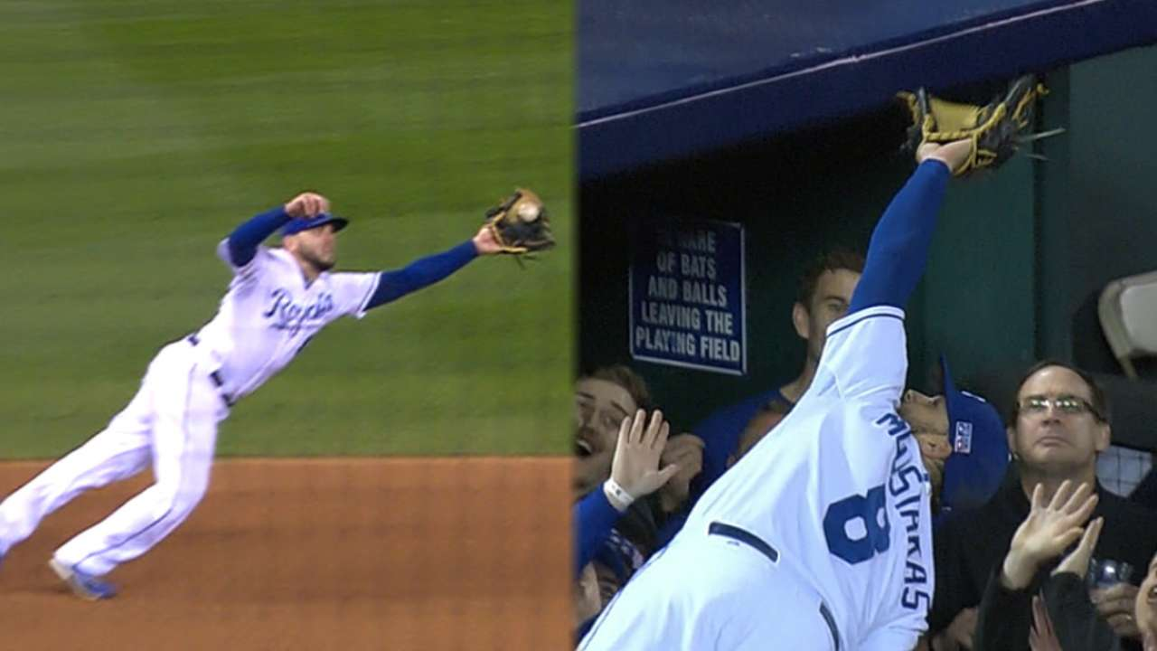Crowdsourcing: Moustakas leaps into stands for amazing catch