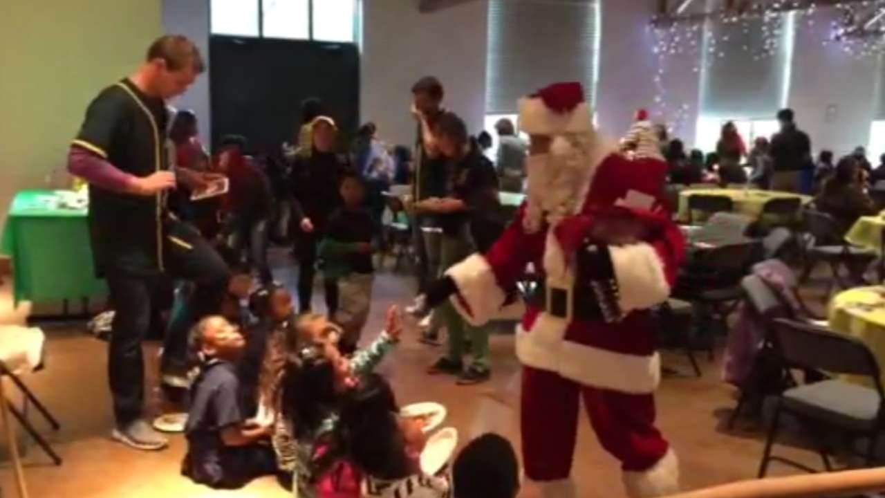 Trio of A's help bring holiday cheer to Oakland school kids