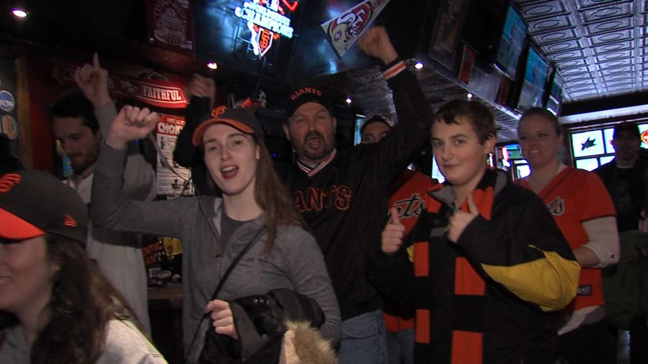 NYC fans endure winter weather to visit WS trophy