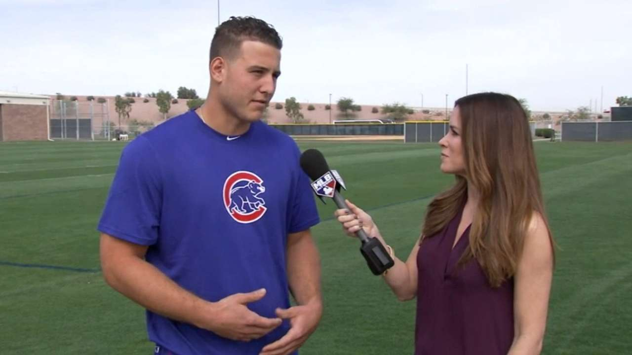 Cubs eager to get to work as pitchers and catchers report