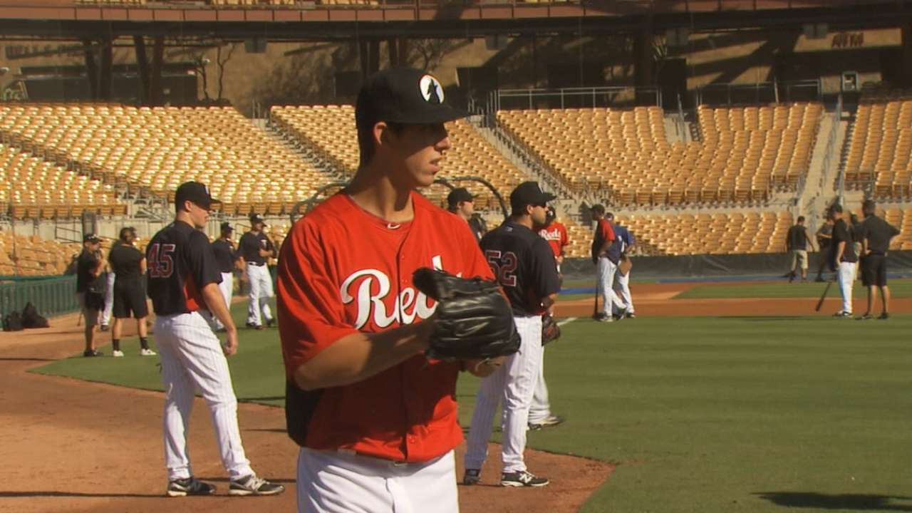 Prospect Lorenzen learning from vets as he eyes spot with Reds