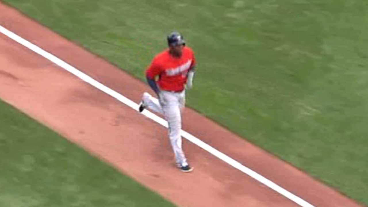 Sano's long homer ties game