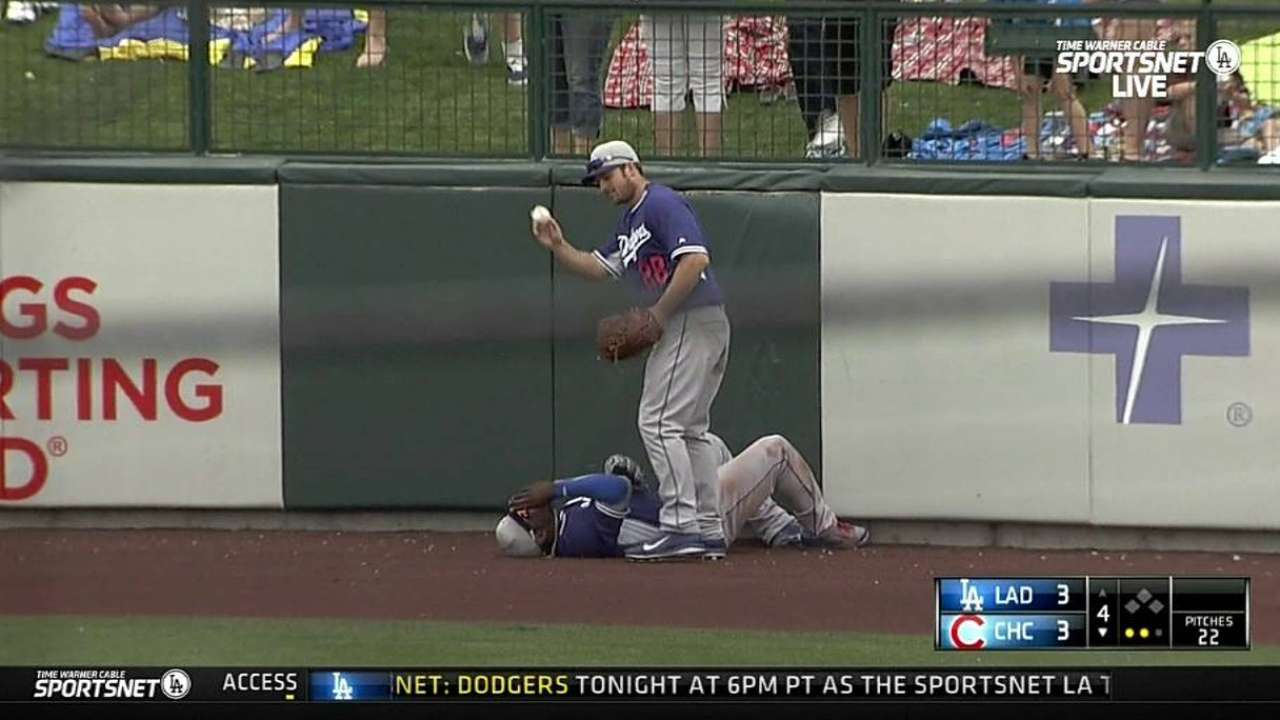 Puig slams into center-field wall to make circus catch