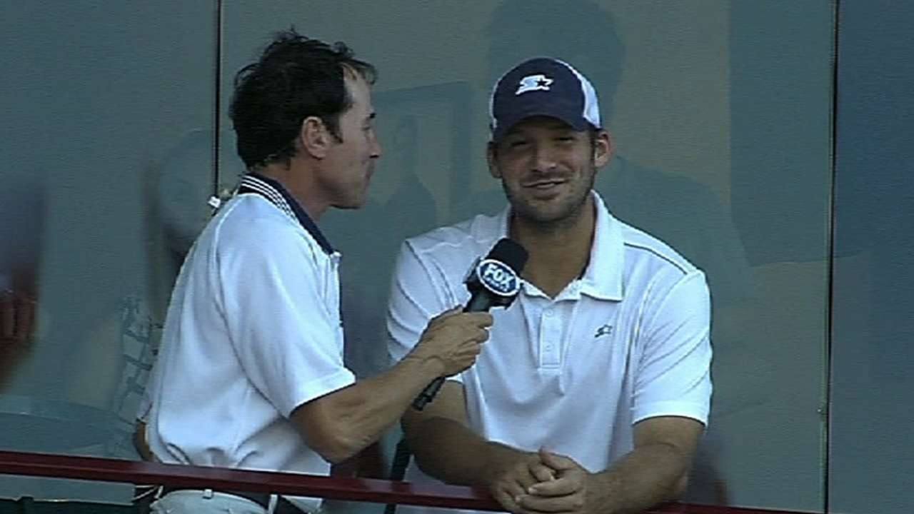 Romo throws the first pitch