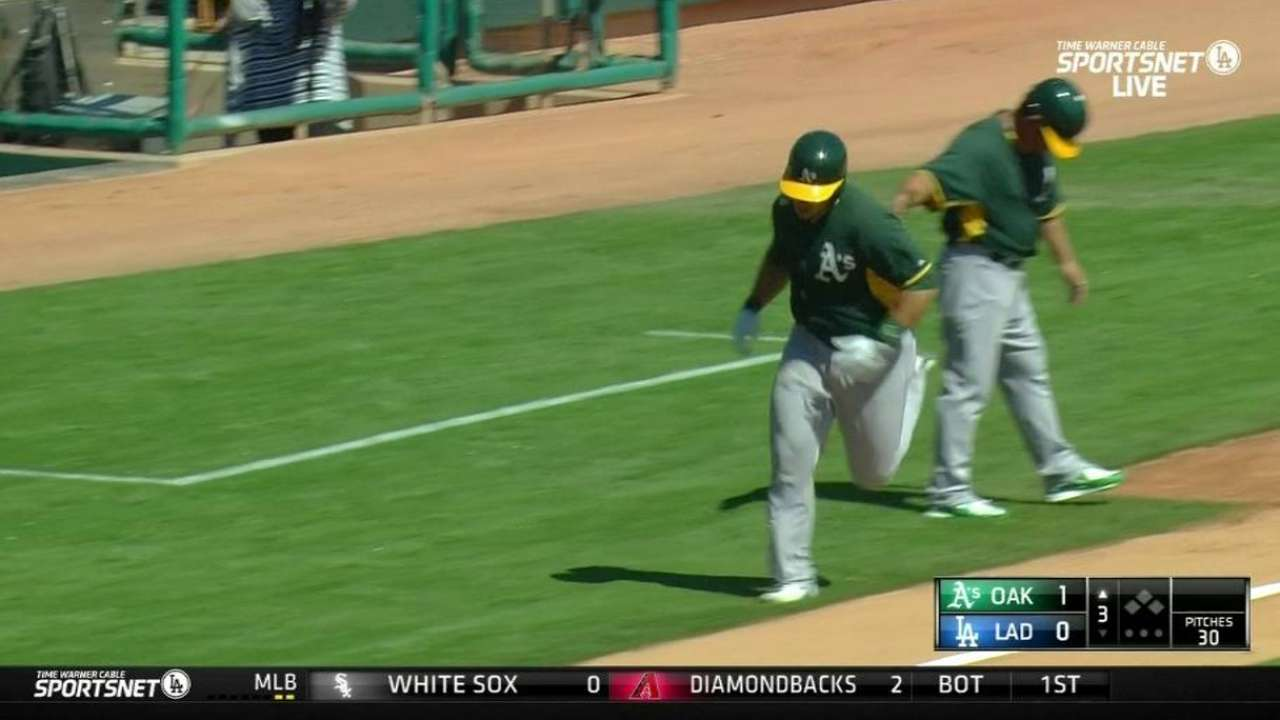 Phegley busts out for A's before Dodgers strike back