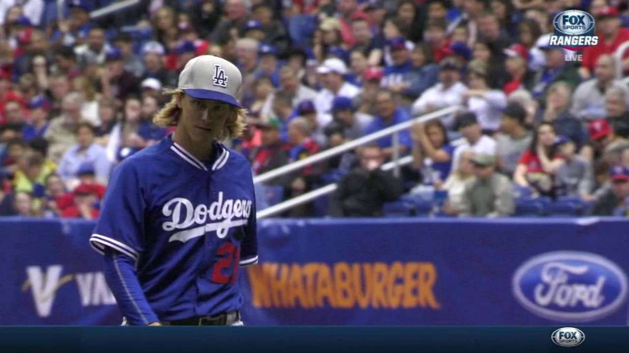 Greinke strikes out the side