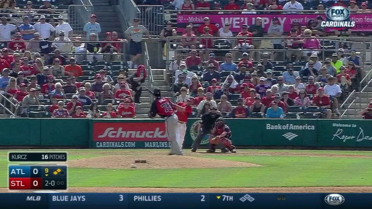 Cards win Wainwright's strong debut in wild fashion