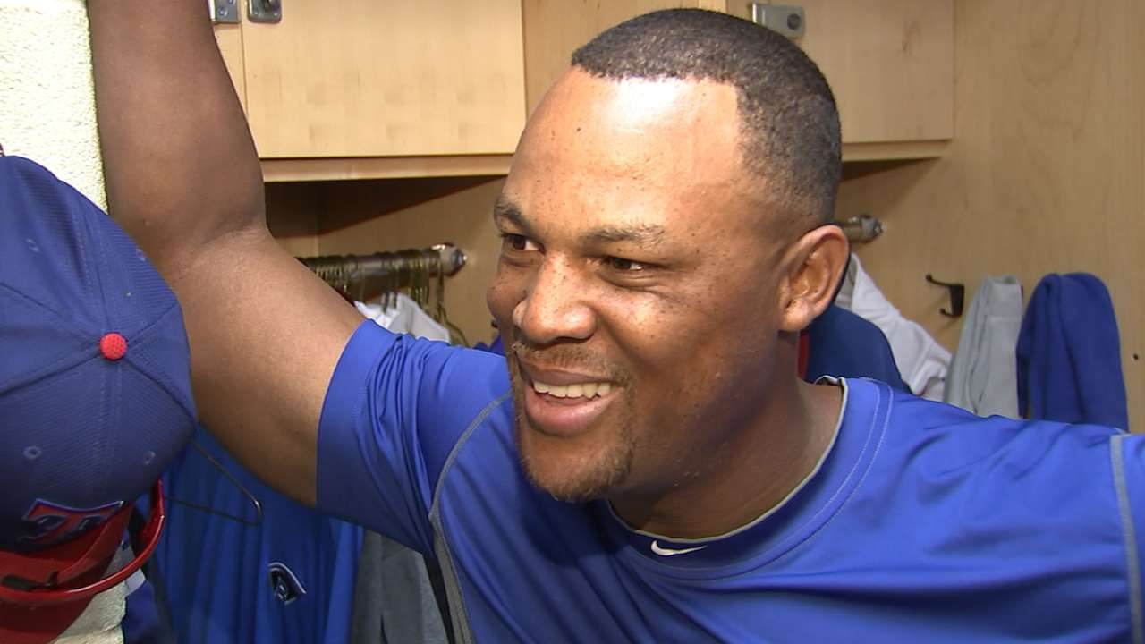 Beltre showing his son spring baseball ropes