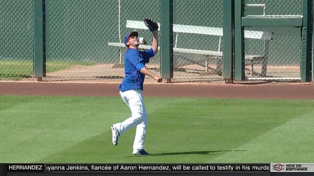 Bryant practices in the outfield