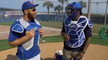 Martin teaches Reynolds how to put on catcher's gear