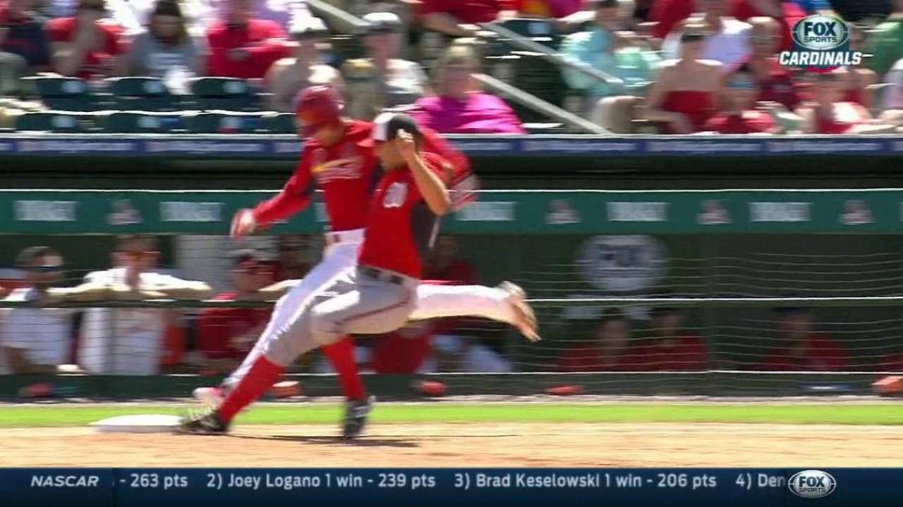 Holliday drives in two to rally Cardinals