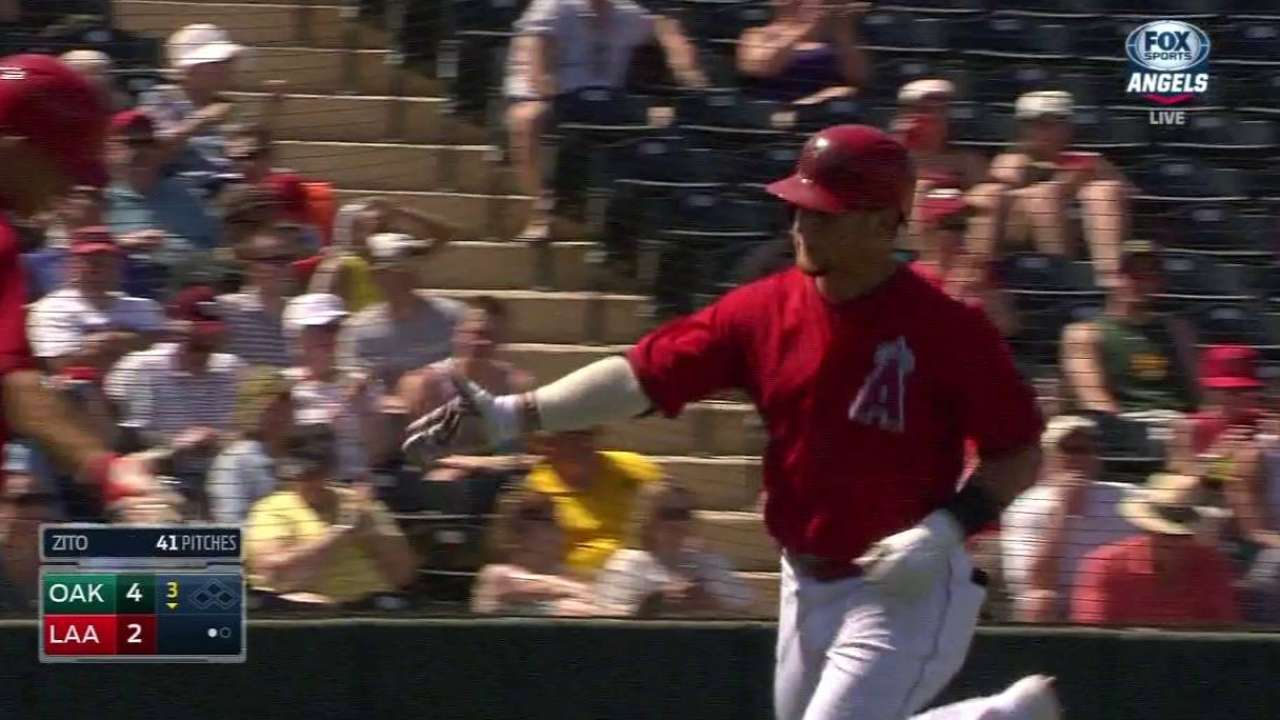 Halos hit three HRs in third, but lose slugfest to A's
