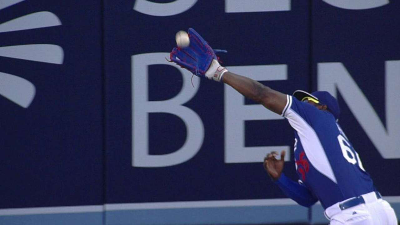 Puig atones for misplay with great catch in fourth inning