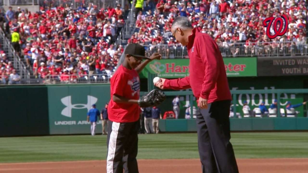 Manfred hands off first pitch