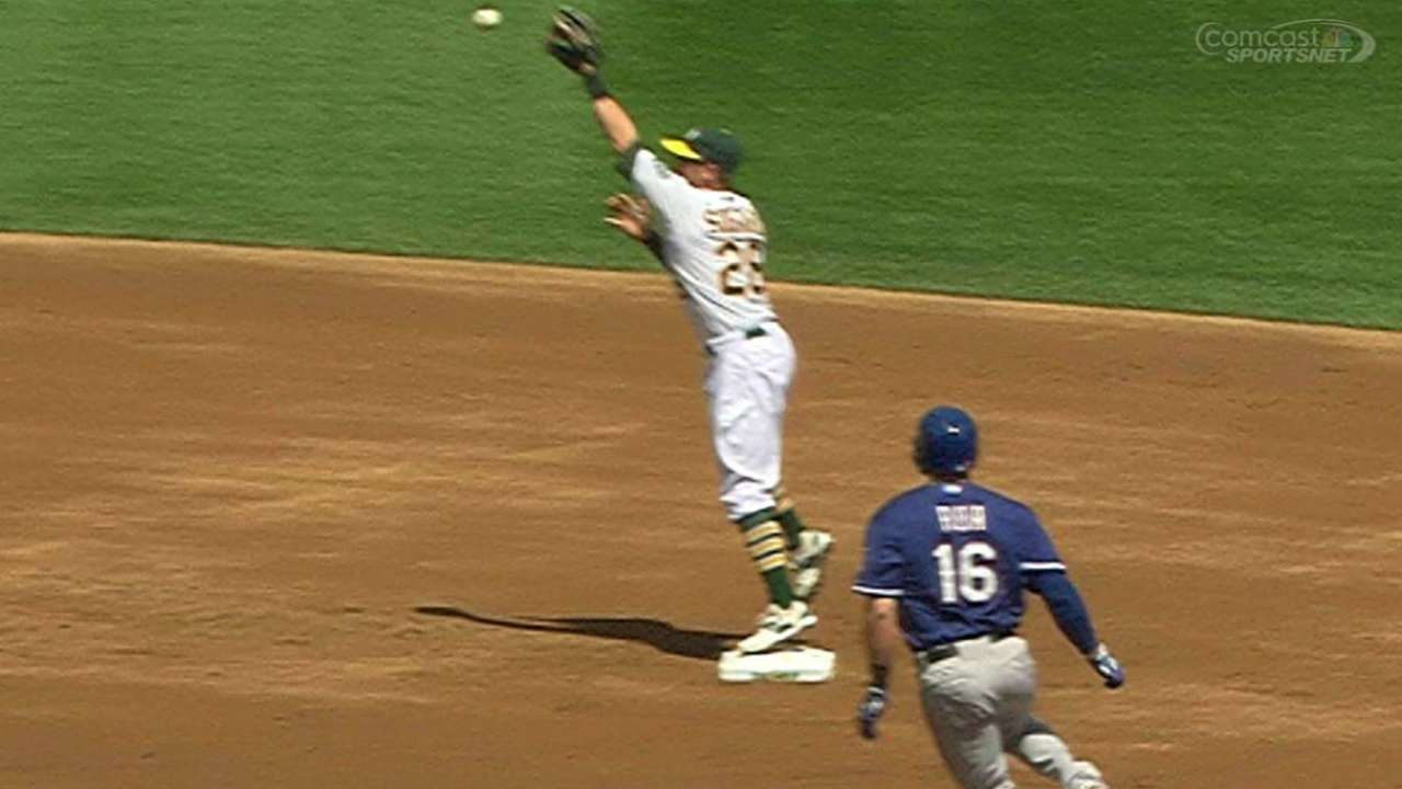 A's escape jam with wacky, replay-aided double play