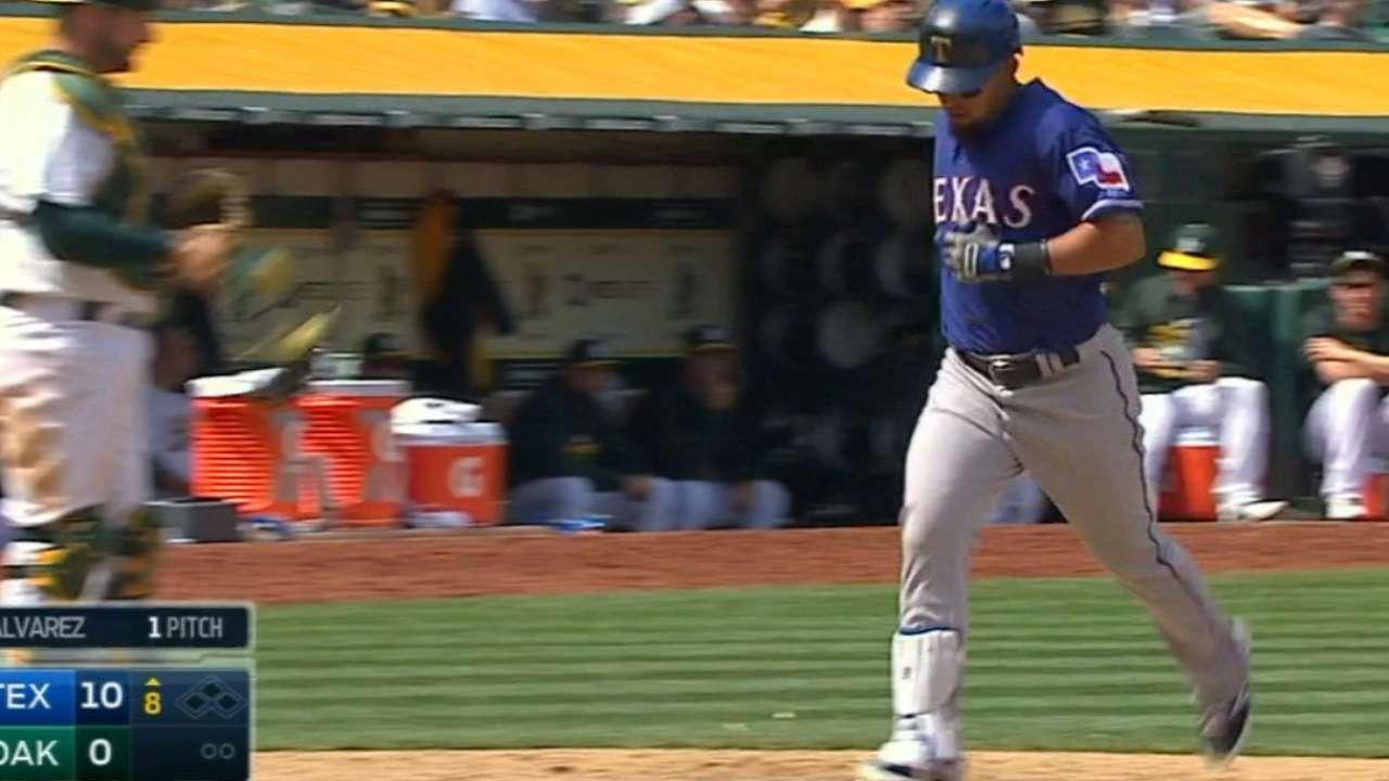 Rangers crush four homers