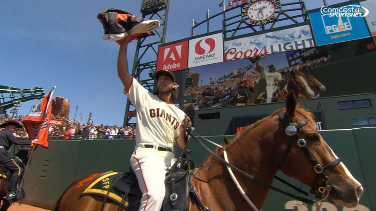 Bumgarner's ride highlights Giants' flag raising