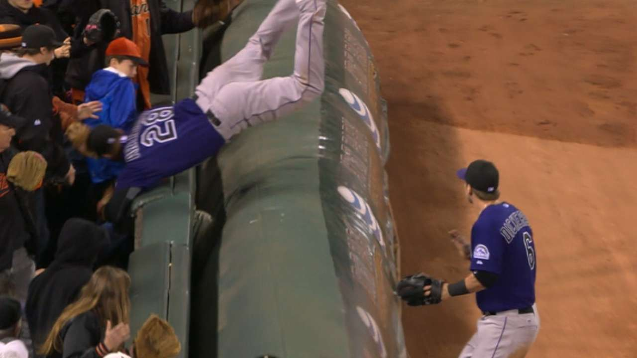 Must C: Arenado flips over tarp