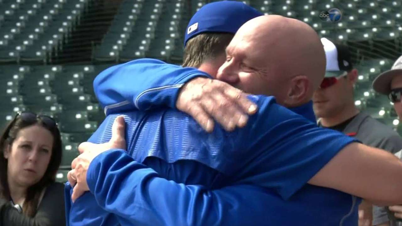 Bryant and his father embrace