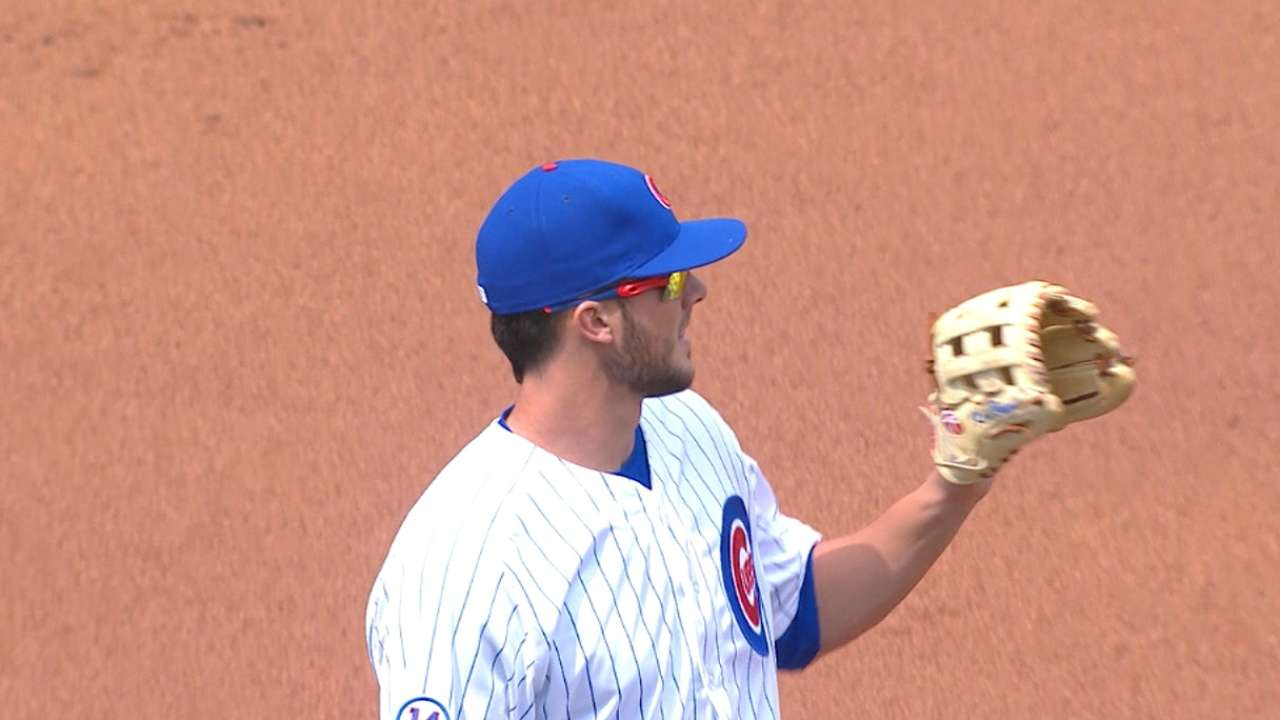 Bryant shows off glove in debut