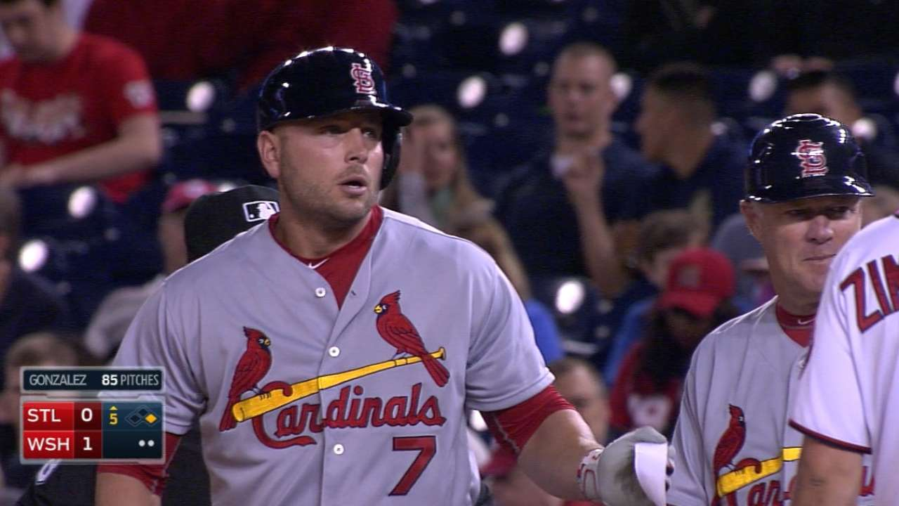 With four singles, Holliday's hitting streak at 12 games