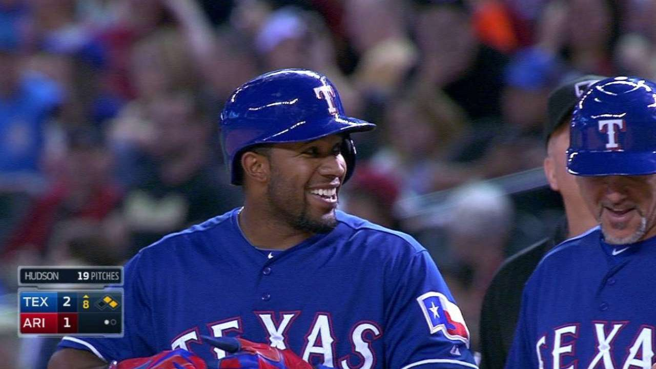 Rangers' offense erupts late in win over D-backs