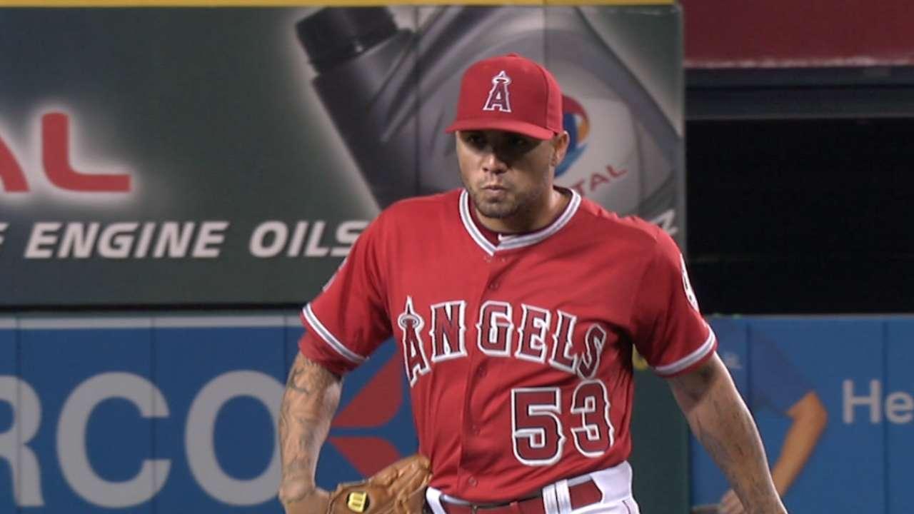 Santiago strikes out eight A's