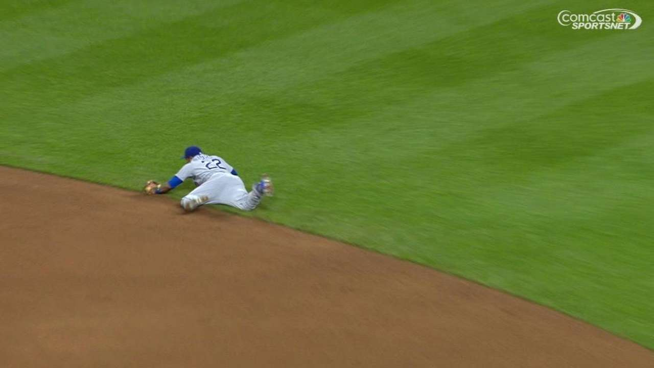 Russell makes diving stop to throw out speedster Hamilton