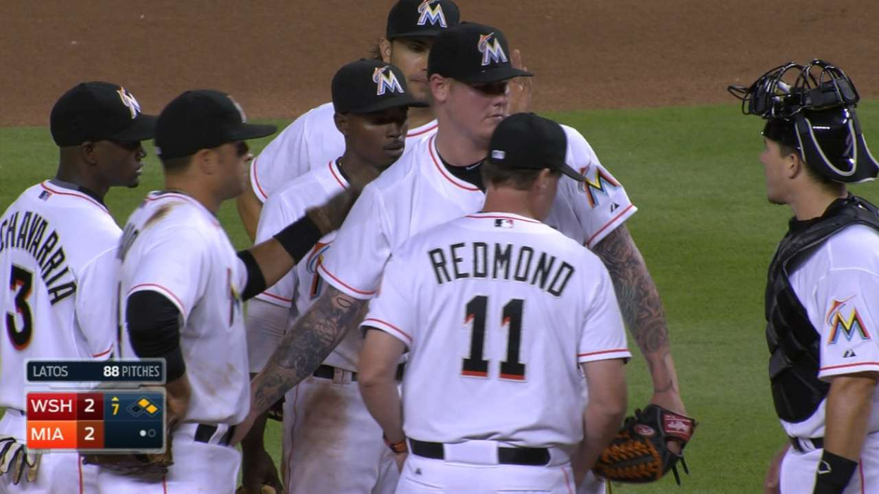 Latos provides spark on the mound, at the plate