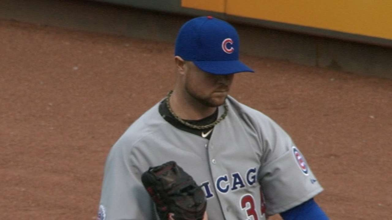 Lester improves, strikes out 10 against Reds