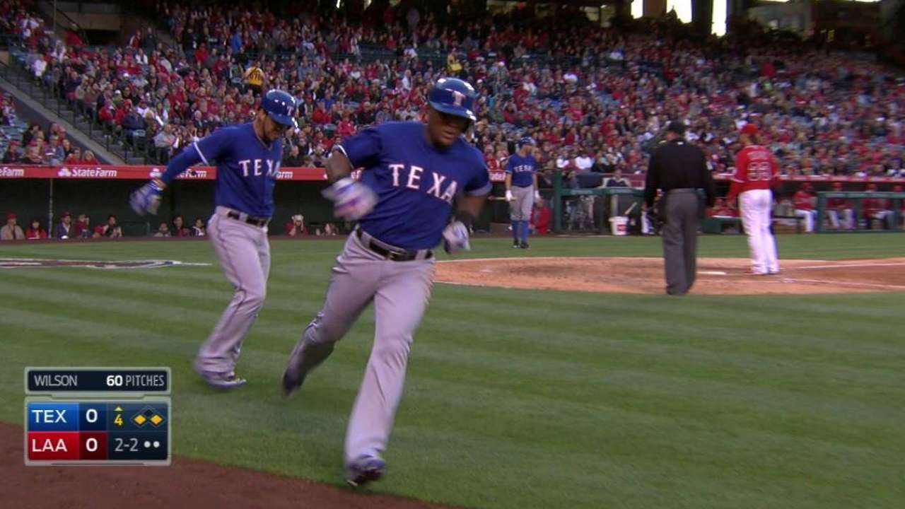 Beltre scores on wild pitch