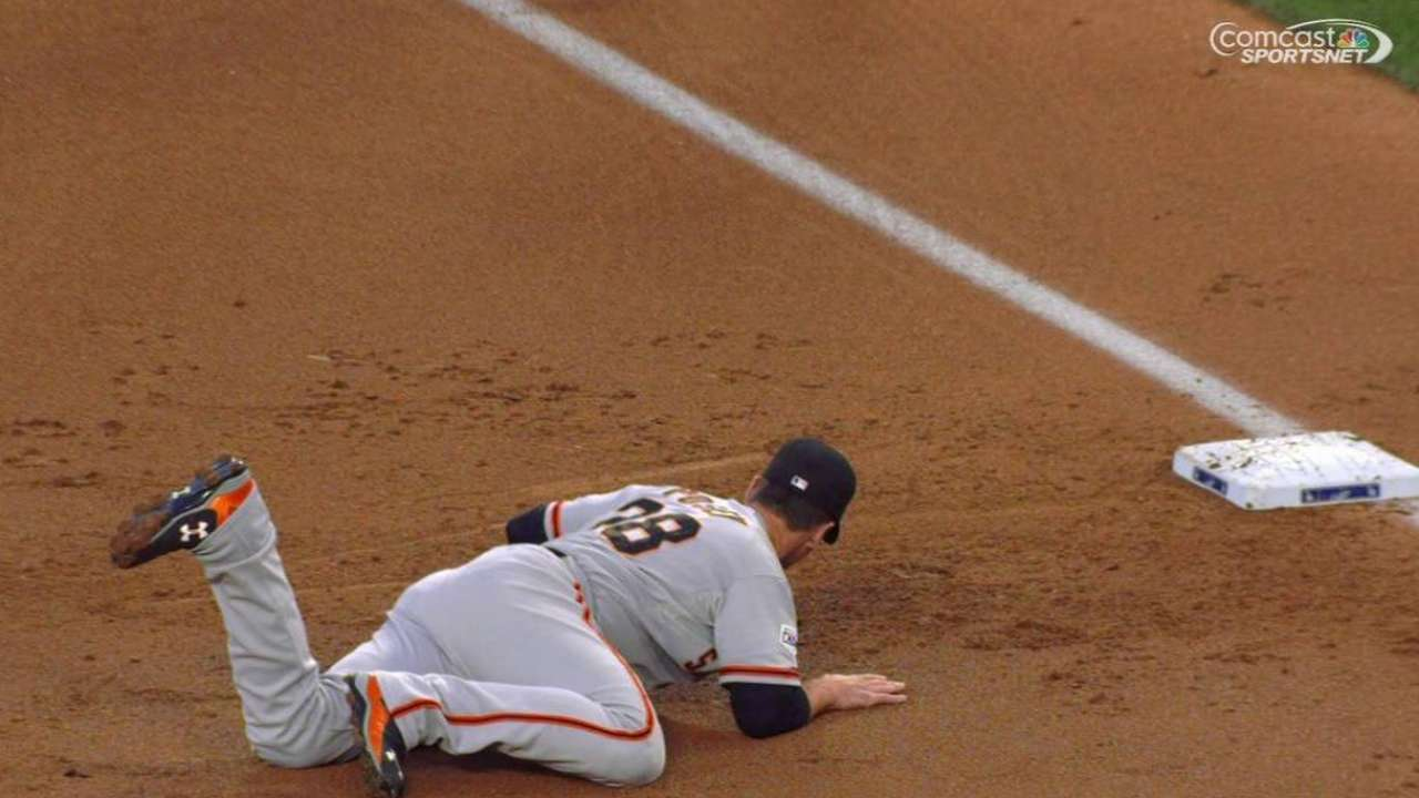Posey's grab helps turn two
