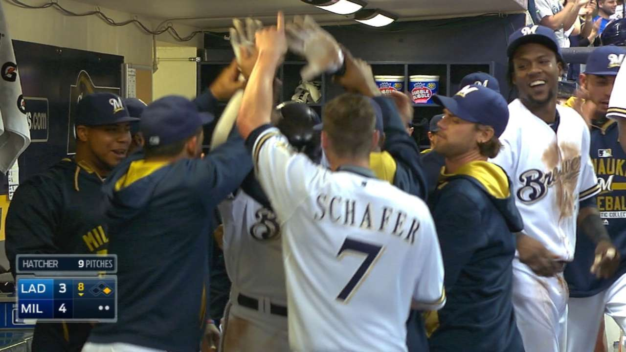 Brewers rally to win Counsell's debut