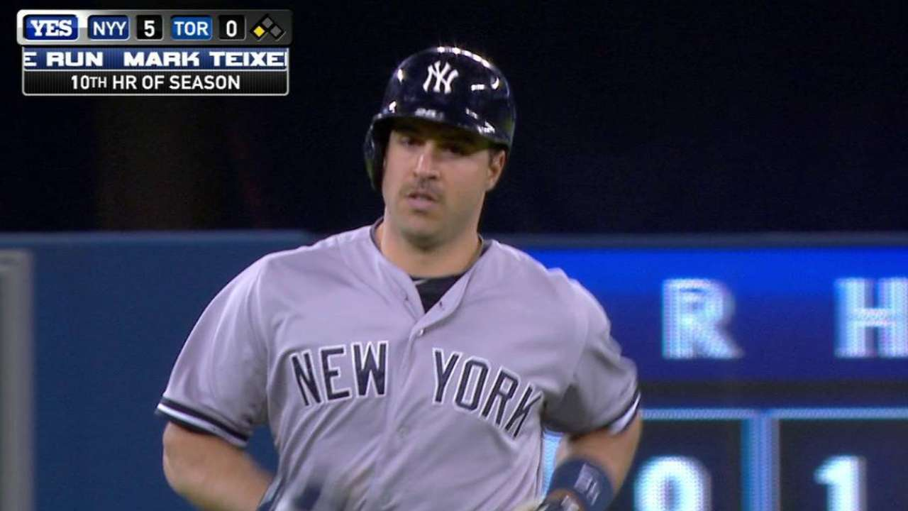 Lat injury no problem for homer-hungry Teixeira