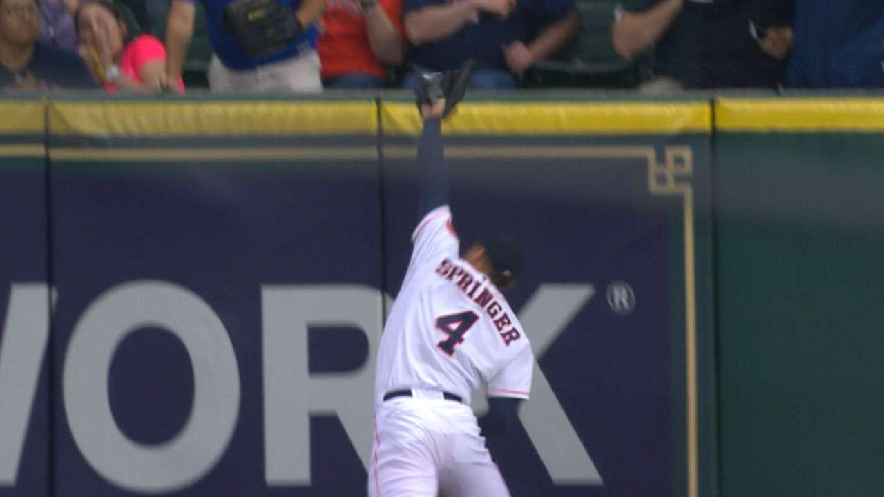 Springer's wall-crashing catch