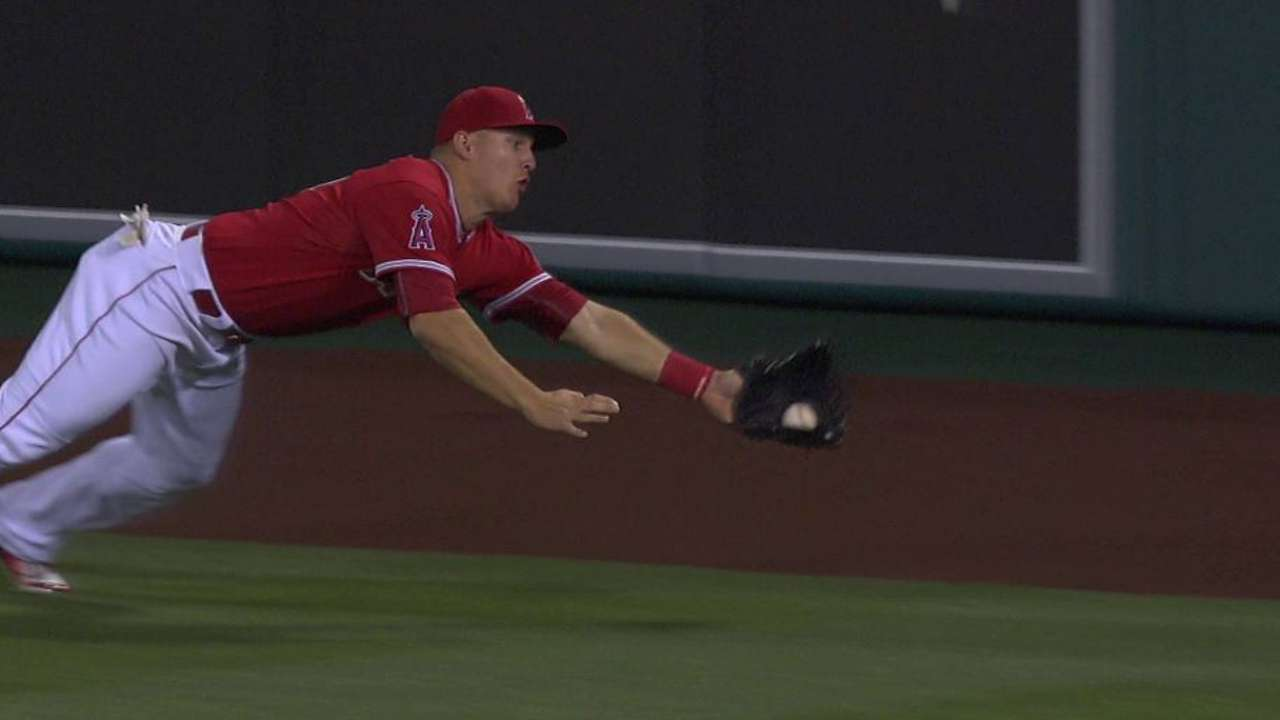 Trout homers, halts rally with diving grab