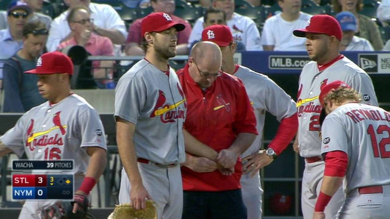Wacha loses glove on comebacker