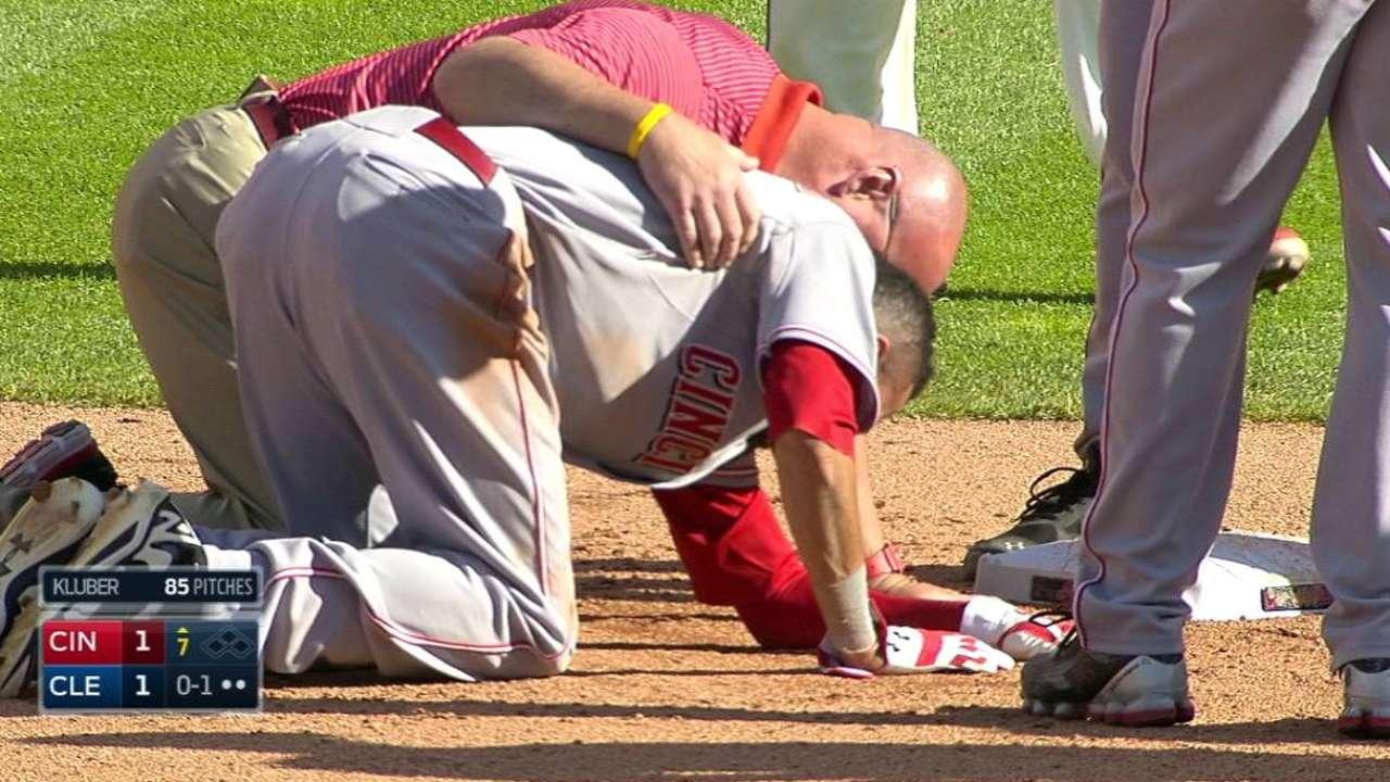 Hamilton hurt on slide, stays in