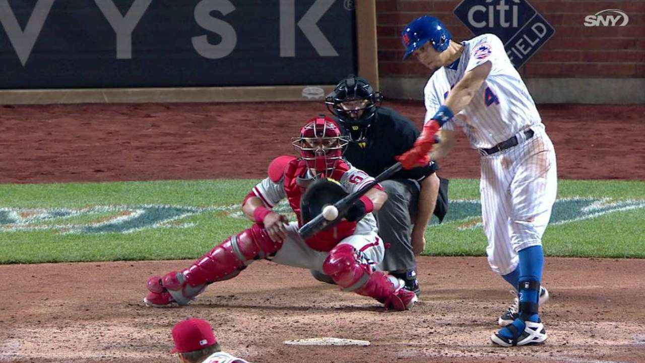 Flores' game-tying sacrifice fly