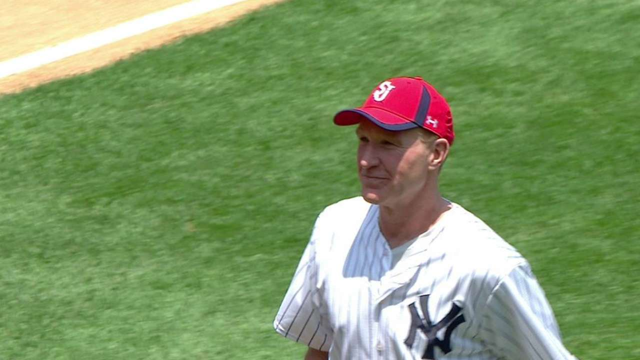 St. John's coach Mullin throws first pitch