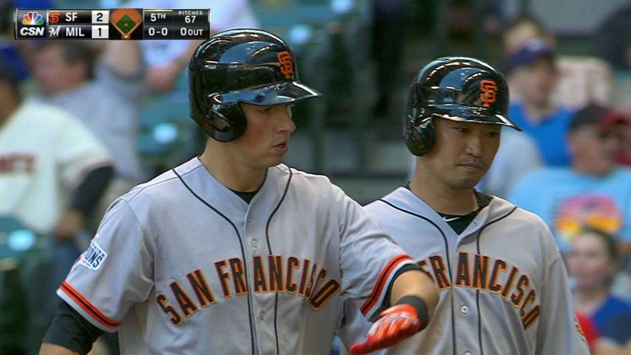 Giants complete sweep behind Vogelsong