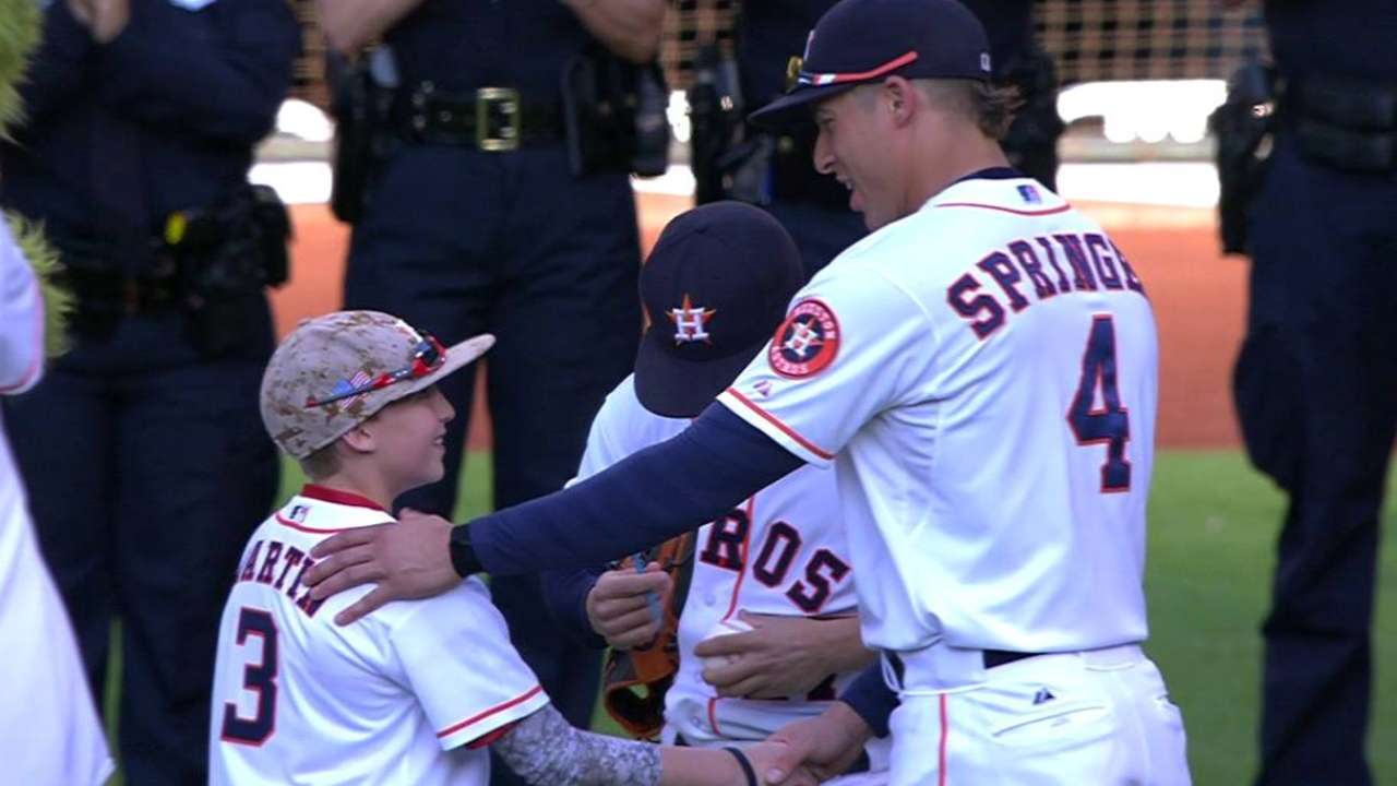 Son of fallen Houston officer throws 1st pitch