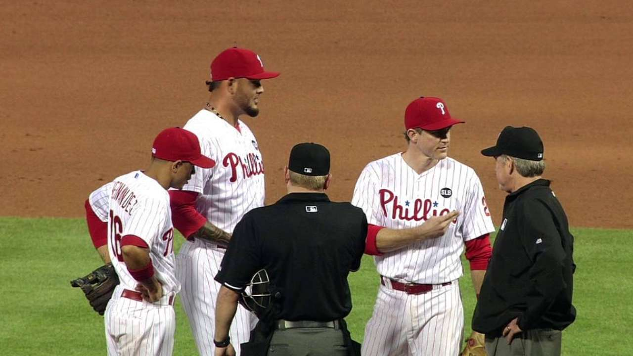 Umpires inspect Araujo's glove