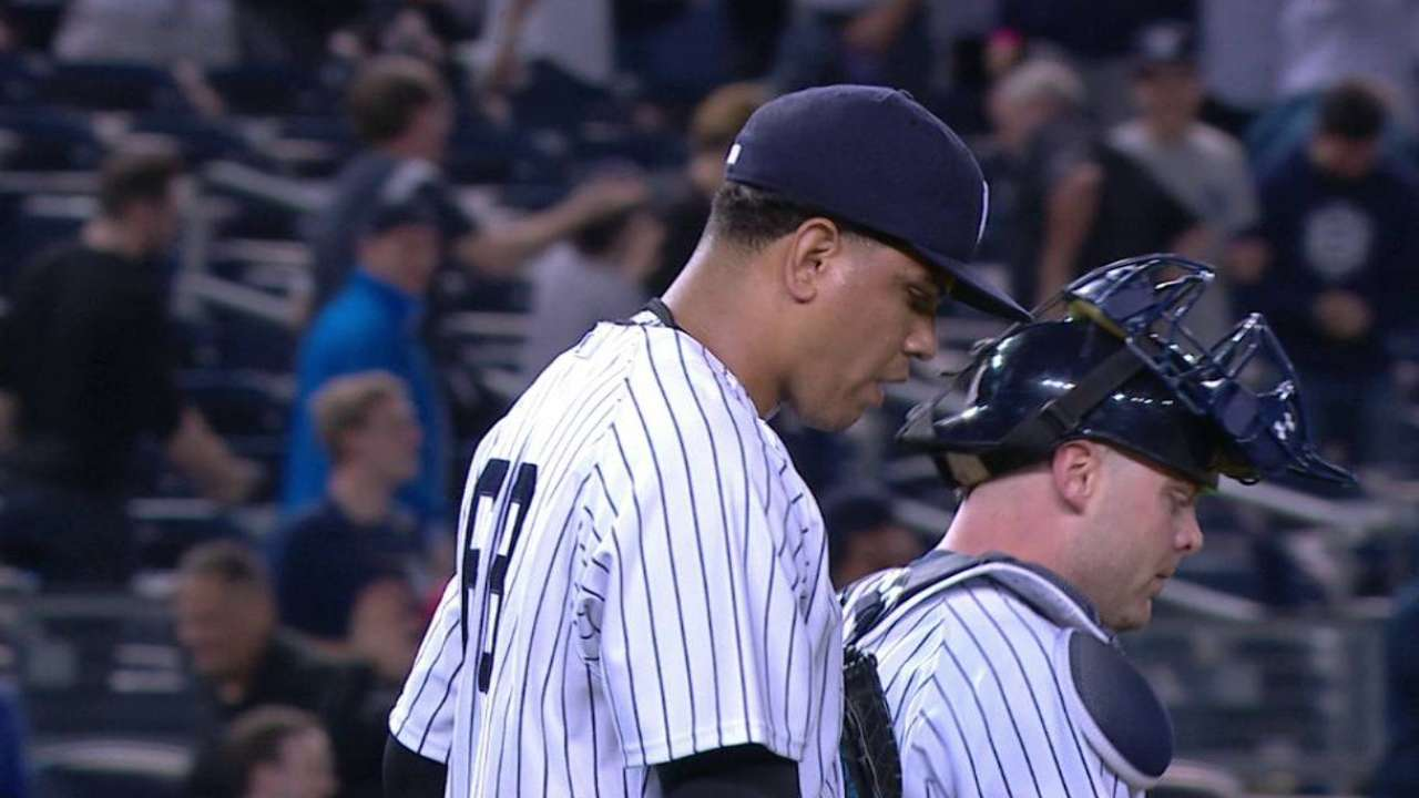 Yanks stave off furious rally to edge Angels