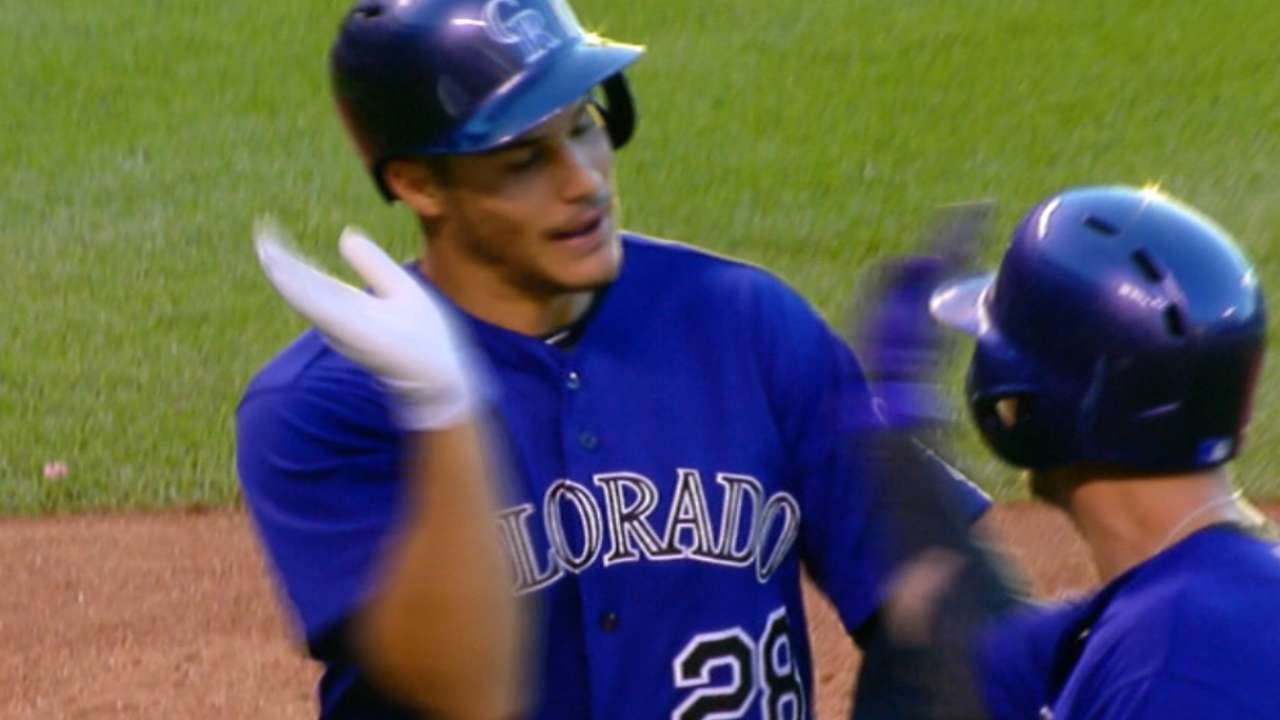 Rockies score five in the 4th