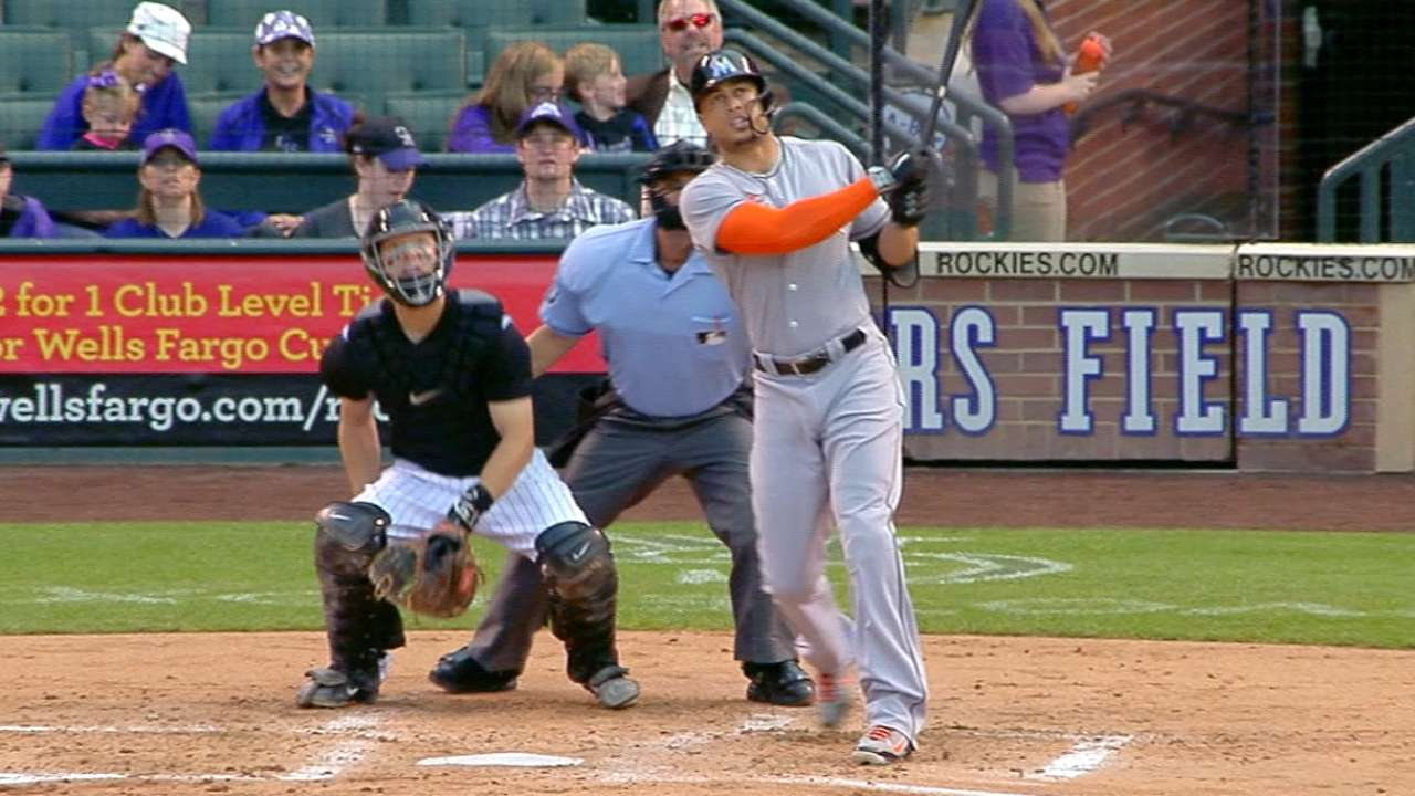 Marlins crush at Coors, hold on after long delay