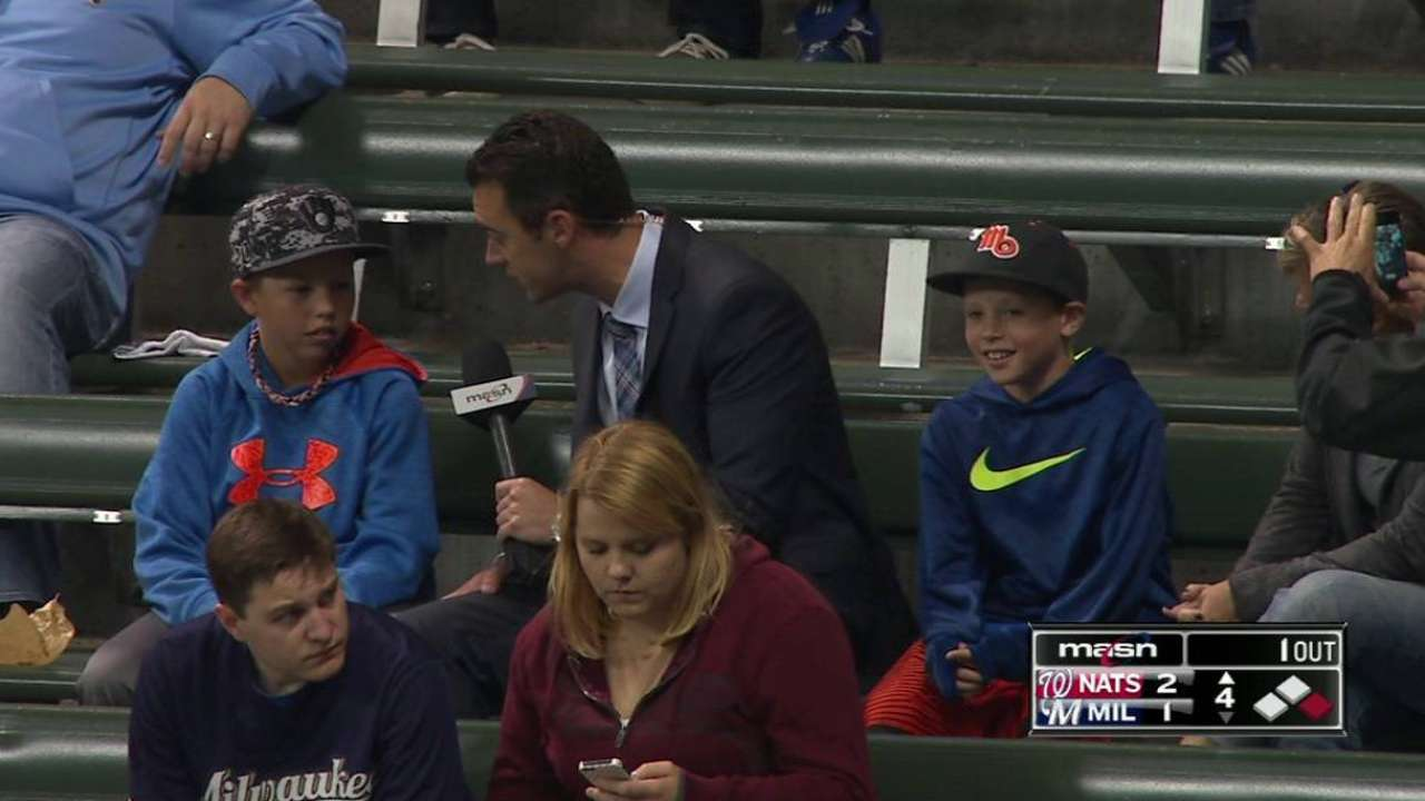 Young fan on trading ball
