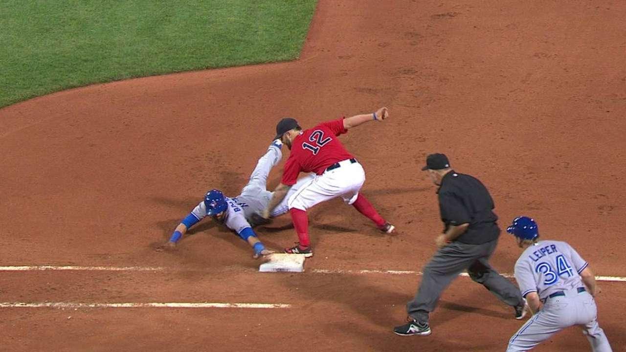 Bautista safe at first stands
