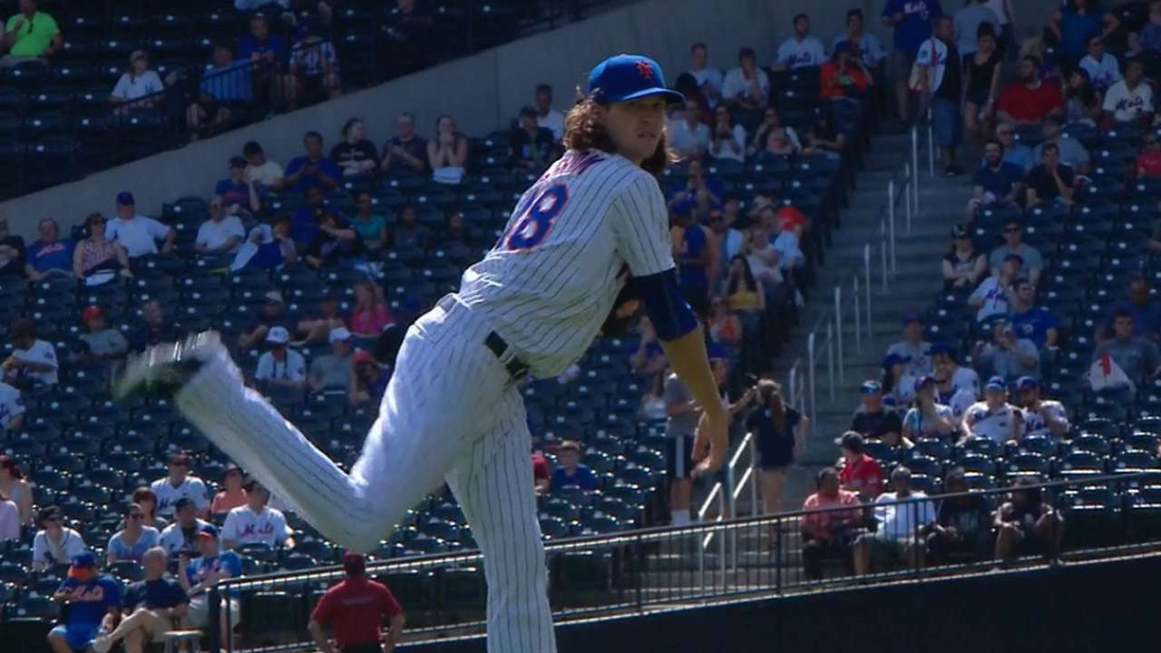 deGrom shrugs off errors to notch strong start