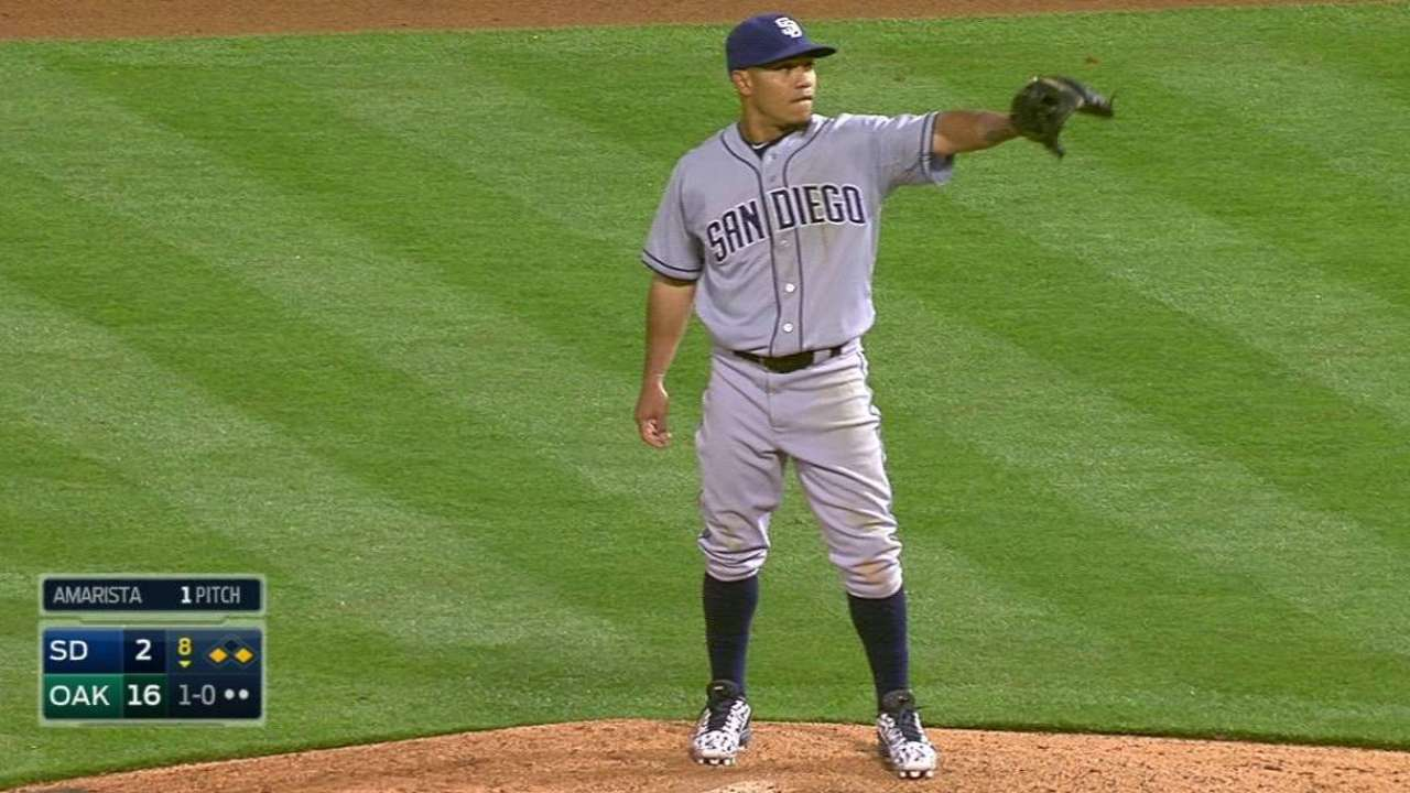 Amarista takes mound in 8th, flashes 'fastball'